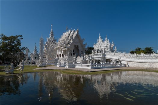 "Wat Rong Khun ""The White Temple"" of Chiang Rai - Wat Rong Khun, better known as ""the White Temple"" is one of the most recognizable temples in Thailand. The temple outside the town of Chiang Rai attracts a large number of visitors, both Thai and foreign, making it one of Chiang Rai's most visited attract"